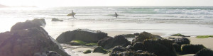 Surfers return to Porthmeor Beach St Ives Cornwall